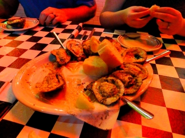 Grilled oysters at Acme Oyster House in New Orleans, LA