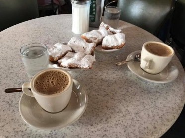 Beignets and coffee at Cafe du Monde in New Orleans, LA