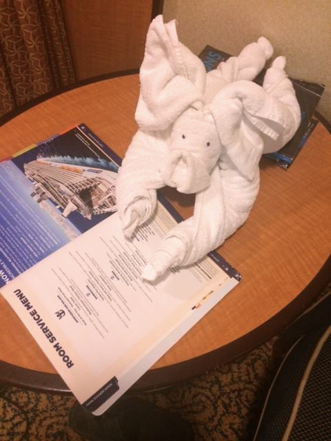 A towel animal in the shape of a pig.