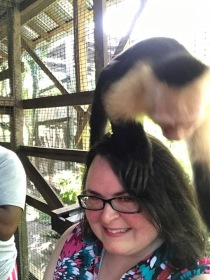 Kathleen with a monkey in Roatan.