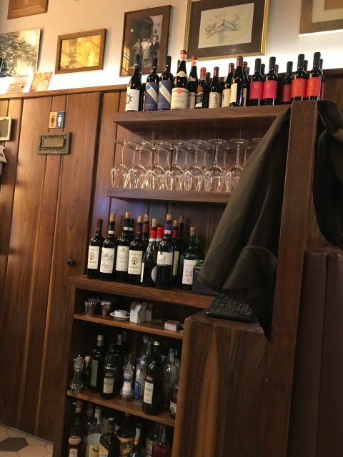 A shelf of wine in a restaurant in Rome, Italy