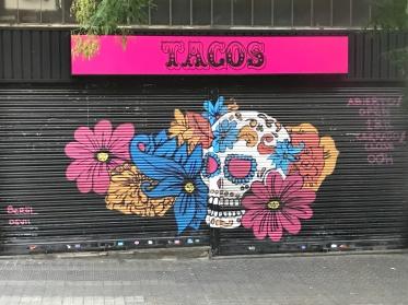 Street art showing tacos and skulls.