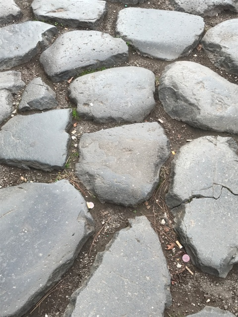 The stones on an ancient roadway in Rome, Italy