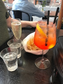 A picture of a spritz at a cafe in Rome, Italy