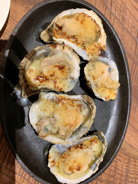 Garlic butter grilled oysters at Whiskey & Oyster in Alexandria, VA