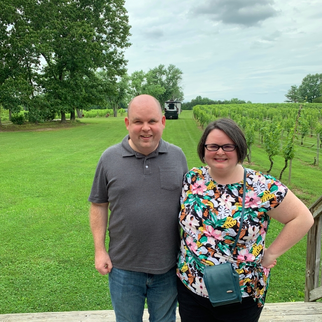 Us standing in the vineyards at Lake Anna Winery