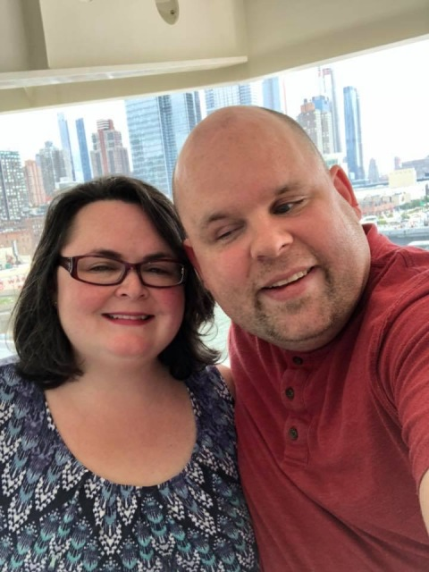 A picture of us on our balcony on the Norwegian Escape cruise ship
