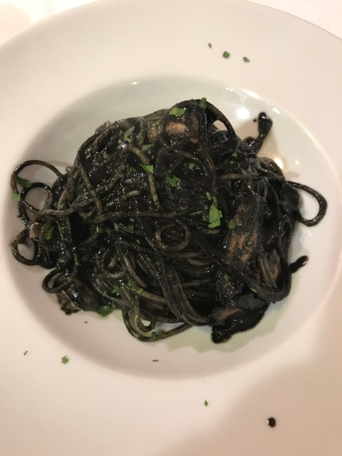 A plate of cuttlefish ink pasta at Da Cherubino in Venice, Italy