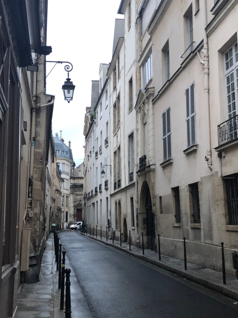 A narrow street in the Marais neighborhood in Paris