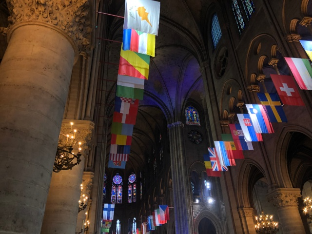 The flags outside Notre Dame Cathedral in Paris, France