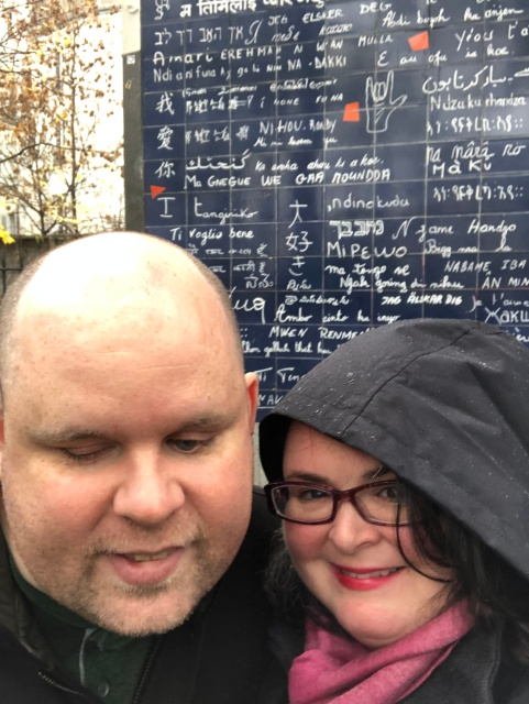 """Us in front of the """"love wall"""" in Montmartre in Paris, France"""