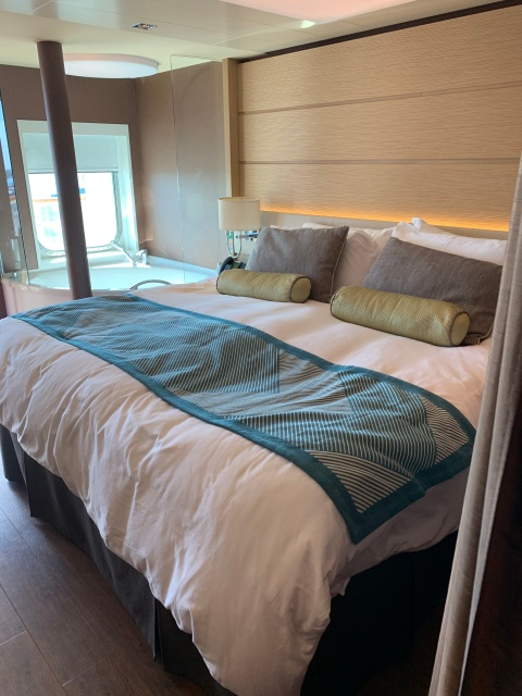 The bed and in-room hot tub in the Haven Spa Suite on the Norwegian Getaway Cruise Ship