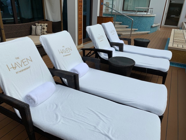 Lounge chairs in the Haven on the Norwegian Getaway Cruise Ship
