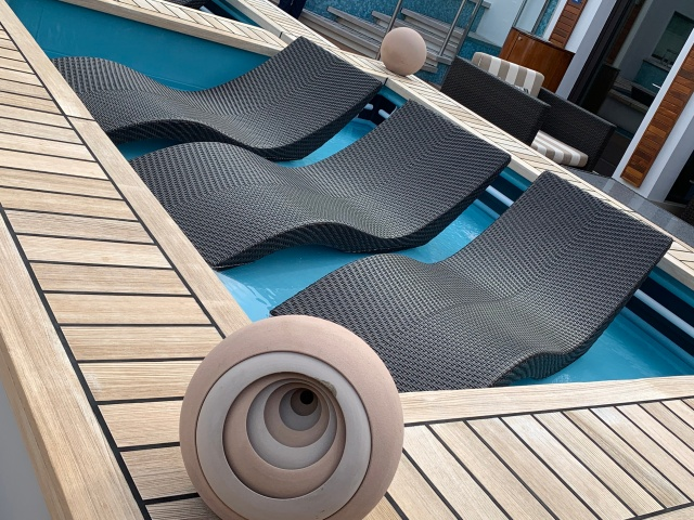 Loungers in the Haven pool aboard the Norwegian Getaway cruise ship
